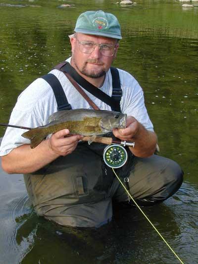 Ian Colin James with Thames River Bass. Copyright © 2001 Ian Scott