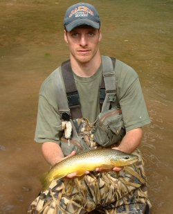 jason akl with brown trout caught on rabid prince fly