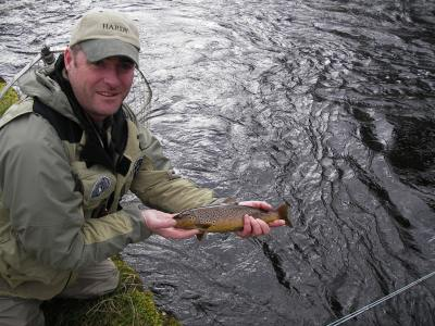 stevie munn with six mile water river brown trout